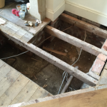 Invasive investigation of dry rot in sub floor void, timber joists and floor boards. Works are often complicated by presence of services such as electric cables.
