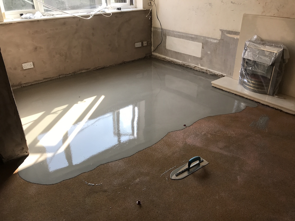 Re-screeding floor (laser levelled) following long term leak and saturation of concrete floor slab. Prior to screeding we applied a liquid polyurethane damp proof membrane to the concrete slab.
